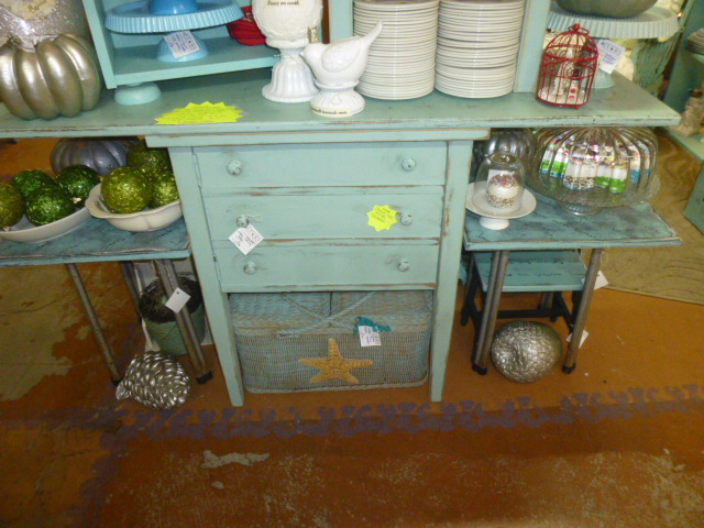 sewing cabinet repurposed into a kitchen island of reduction