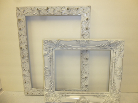 Formerly gold frames spray painted white.
