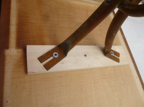 Close up view of how Michael attached the top to the rusty leg base.