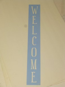"$22. VERTICAL WELCOME: 4"" X 24"""